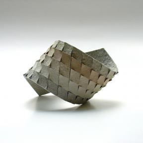 Bracelet made from cardboard by Israeli jewelry designer Dana Hakim