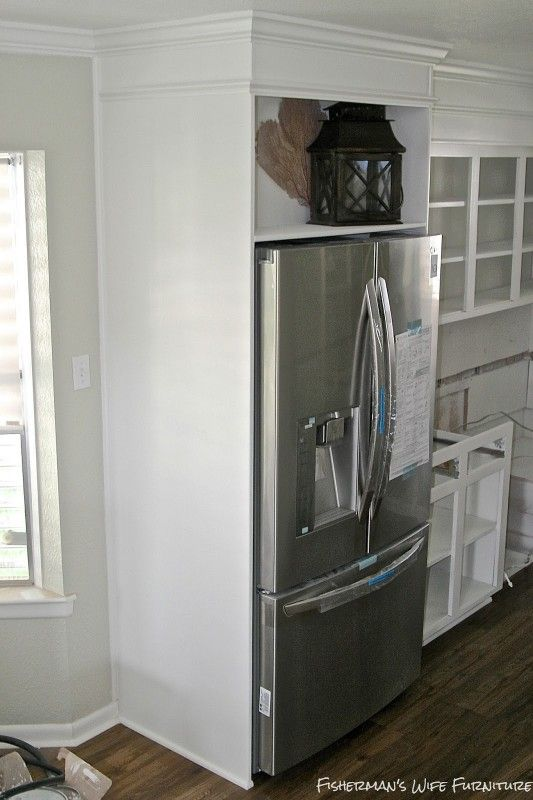Built In Fridge Enclosure In A Small White Kitchen