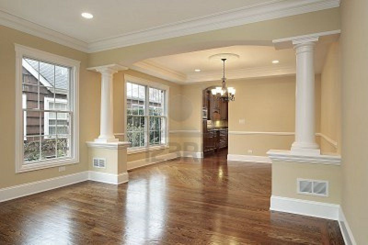 Living And Dining Room With White Pillars In New Construction