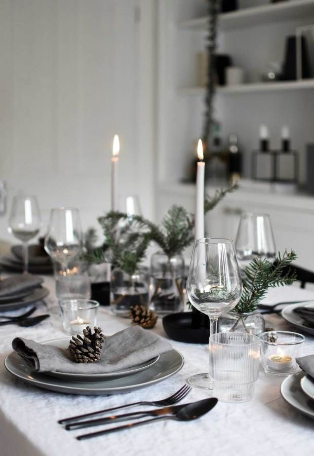 Minimalist Christmas table styling with fir, candles & pine cones (These Four Walls)