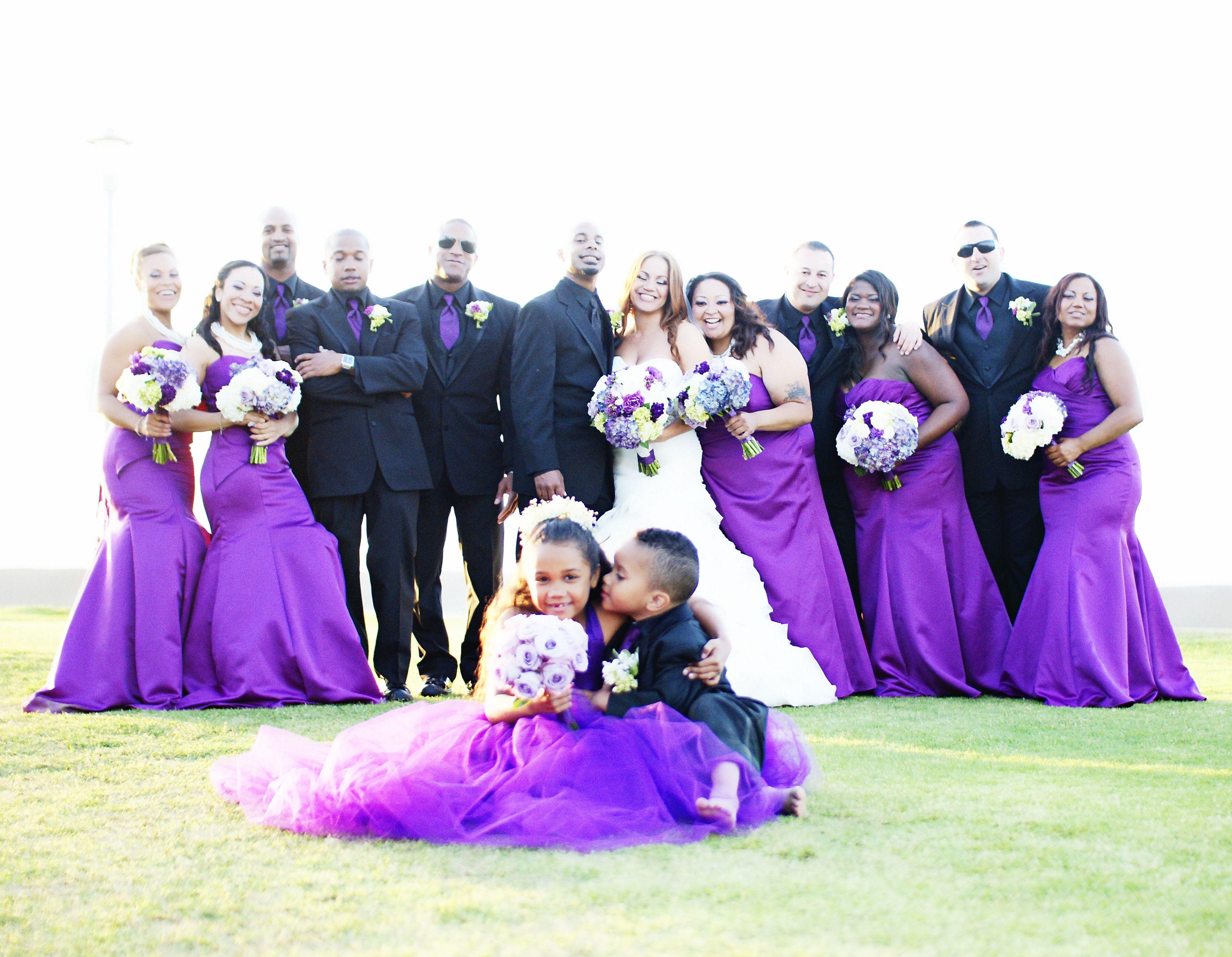 Bridal party at La Jolla Beach. Bright purple bridesmaids dresses ...