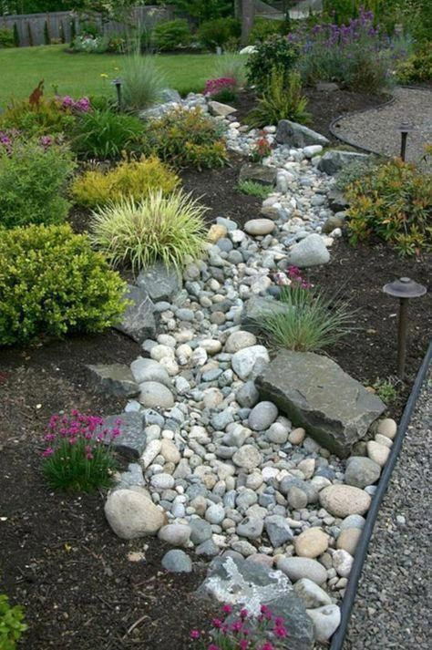 Create a beautiful and low maintenance garden incorporating river rock; landscaping with a dry stream and using river rock to accent your garden. #frontyardlandscaping #riverrockgardens Create a beautiful and low maintenance garden incorporating river rock; landscaping with a dry stream and using river rock to accent your garden. #frontyardlandscaping #riverrocklandscaping Create a beautiful and low maintenance garden incorporating river rock; landscaping with a dry stream and using river rock t #riverrockgardens