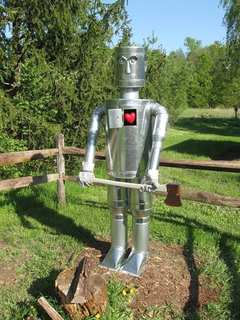 Serenity In The Garden Make A Tin Can Man In Your Garden Tin Can Man Tin Can Art Tin Can