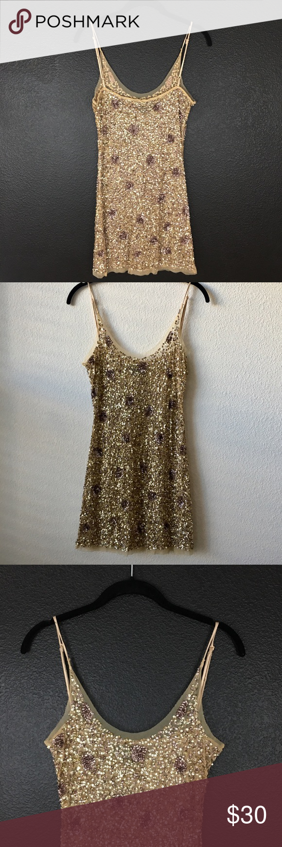"""Adrian B. Rose Gold Mini Sequence Party Dress M Do you need a party dress or would you like to have it on hand?  Adrian B. Rose Gold Mini Sequence is a prefect choice'. Two tone with Rose and Gold is stunning.  It has shear lining. Picture show different lighting, day, late afternoon, evening, to night. Condition: NWOT New without tags Style:  Mini Sequence Dress Size: Medium  Color: Rose Gold Material:  Sequence Measurements:  Bust 34 Waist 32 Hip 34 Shoulder to Hem 28"""" Dresses Mini"""