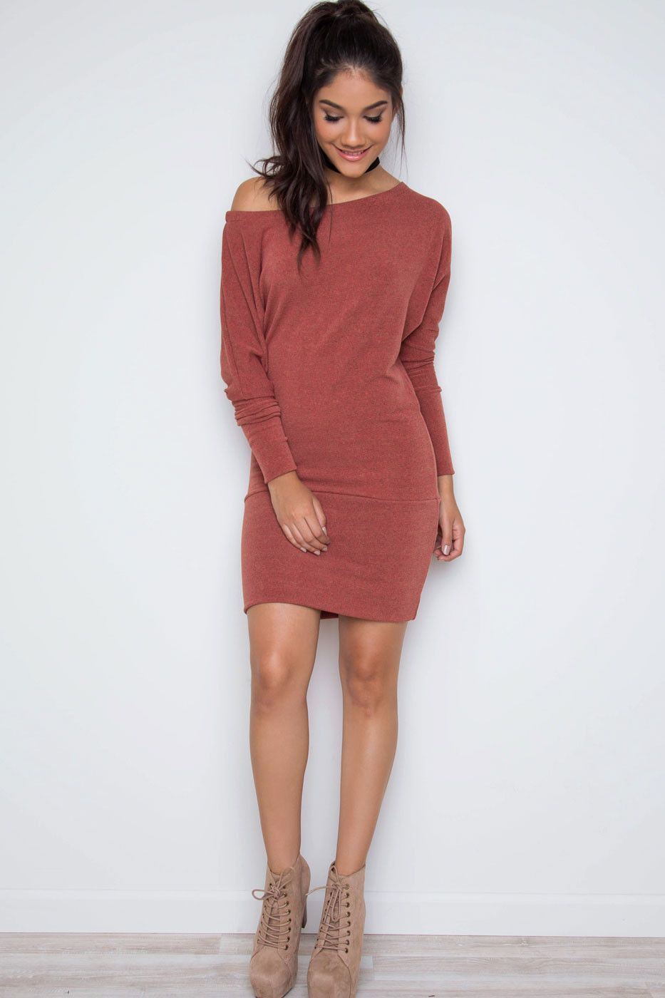 - Details - Size Guide - Model Stats - Contact Dare to dream in this rust Maureen Dress! Featuring a lightweight, ribbed-knit fabric with stretch. Boatneck. Long, dolman sleeves. Optional off-the-shou