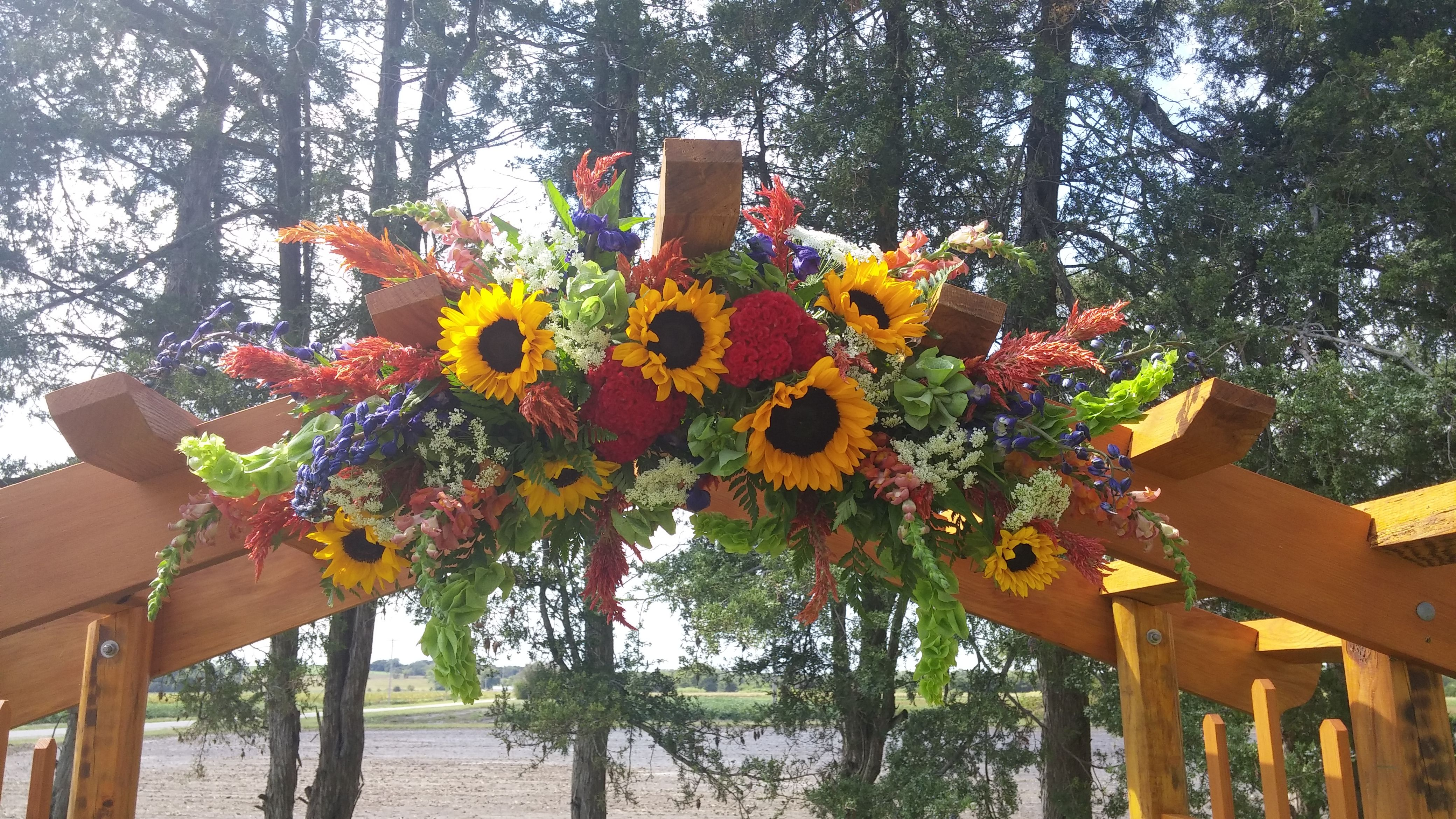 Arch flowers by Kistner's Flowers Sunflowers, celosia