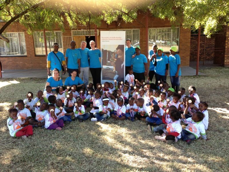 Staff, volunteers and children day one sports week organized by GetOn and sponsor United Cubs in South Africa.
