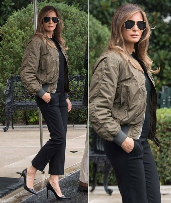 201ec6bd FLOTUS First Lady Melania Trump business casual in an army green bomber  jacket and heels. She has great style! #MyFLOTUS