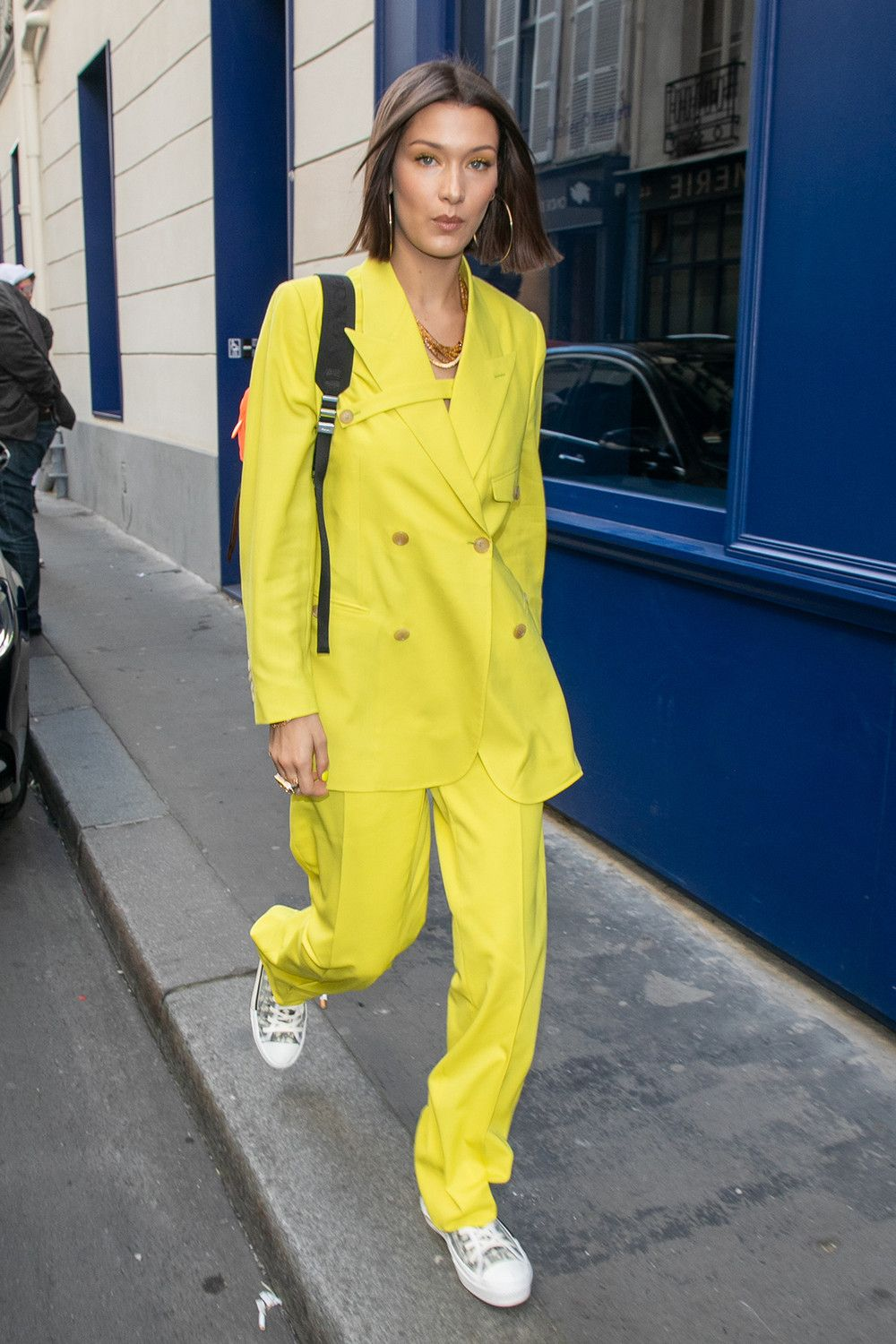 291bbe35c8a Bella Hadid Dior Homme Men Yellow Suit Fluorescent Prada Backpack Sneakers  Paris Fashion Week