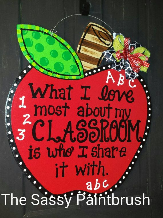 Apple Door Hanger, teacher gift, back to school door hanger, teacher welcome sign, back to school decor, what I love about my classroom is part of School doors - An apple a day! ;) This is an adorable way to welcome the kiddos to class!  24 X 21 inches  Ready to hang straight out of the box   All of our wooden door hangers are hand cut and hand painted with love just for you!  ) We seal them with Polycrylic to protect the color    Ribbons may vary but will always coordinate with the design   I recommend hanging the door hanger under a covered porch or patio to protect it from direct contact with the weather   This will help your SASSY door hanger to remain FABULOUS!  )