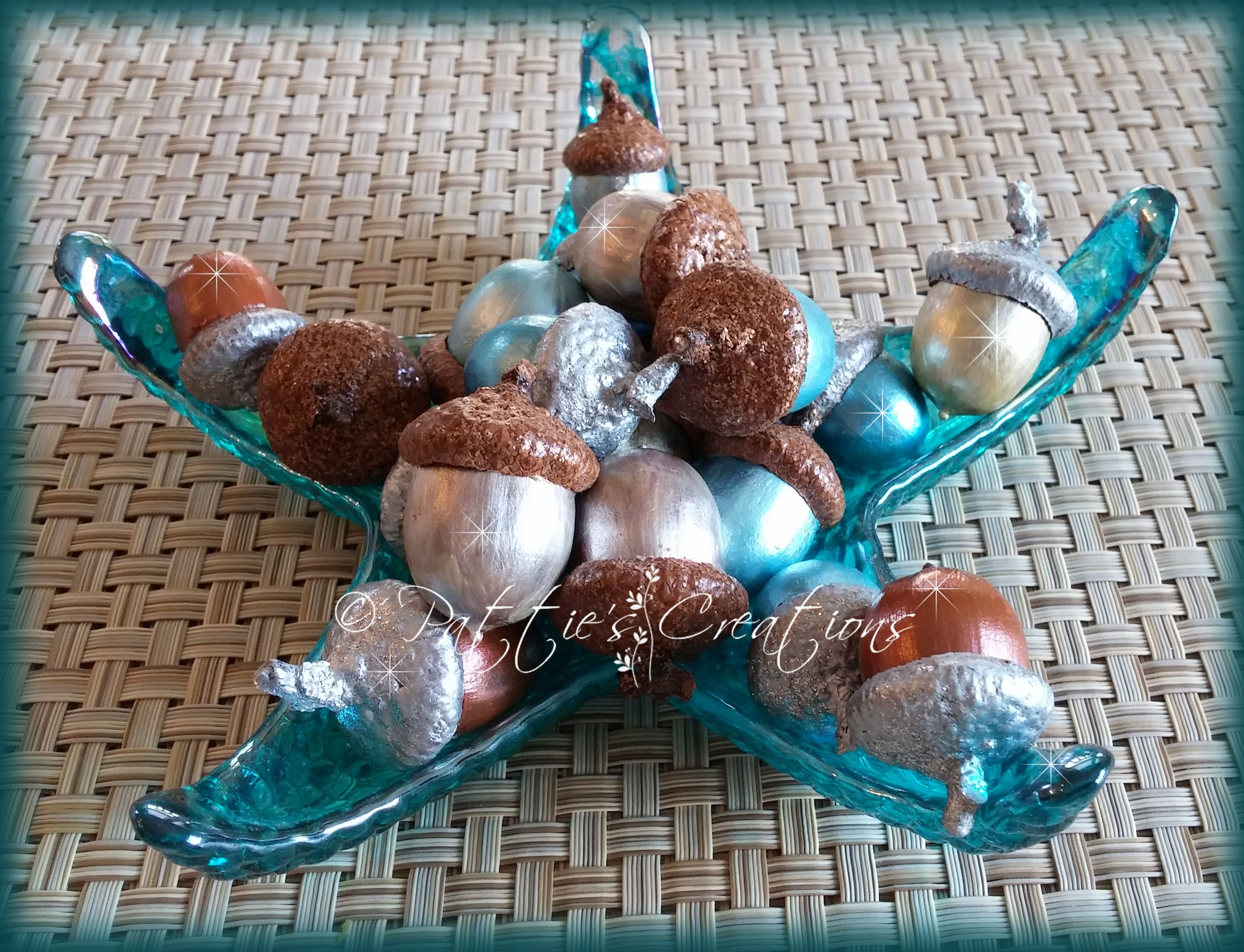 I saw this idea here on Pinterest and I just had to try it. My theme in my new house is Beachy Coastal and I thought this was a great idea to paint acorns in the sea colors. Here is  a photo of how mine came out. I used Martha Stewart Pearl paints and also Liquid Pearls Paints to achieve this look.