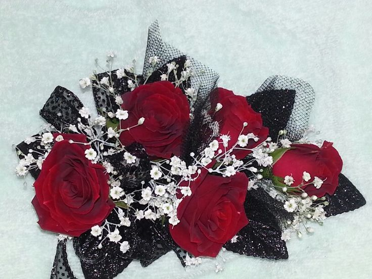 """""""Since your dress is black, I had the lady put some black-and-silver ribbon between the roses,"""" he said, sliding the corsage on my wrist like it was one of the proudest moments of his life. """"Do you like it?"""" """"Now that,"""" I said, smiling down at it. He must have spent a fortune. Red roses streamed halfway up my forearm. """"Is a corsage. Very nice, Mr. Ryder."""" - Crash"""