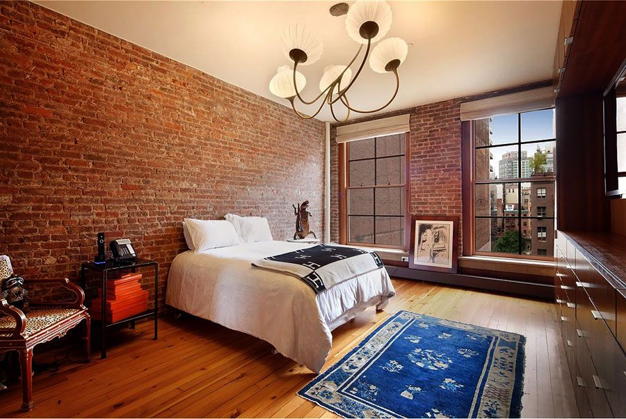 wide loft style apartment bedroom with red brick walls. Chic and Wide Loft Style Apartment in SoHo   Nolita  New York