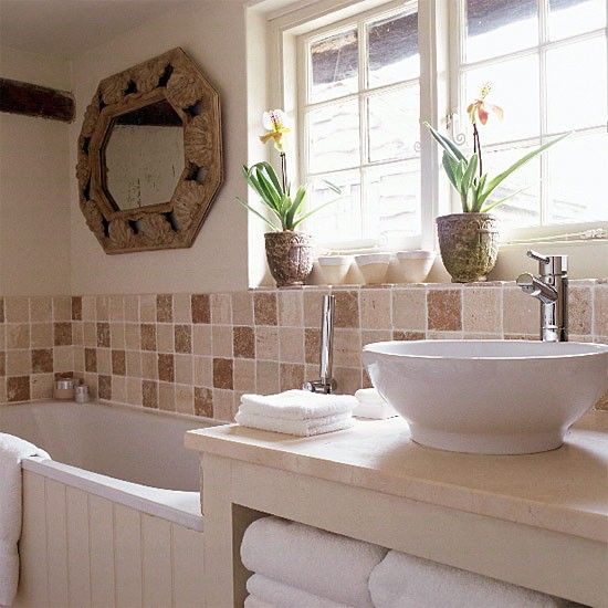 small neutral bathroom with brown tiles and travertine limestone vanity top with surface mounted basin - Cottage Bathroom