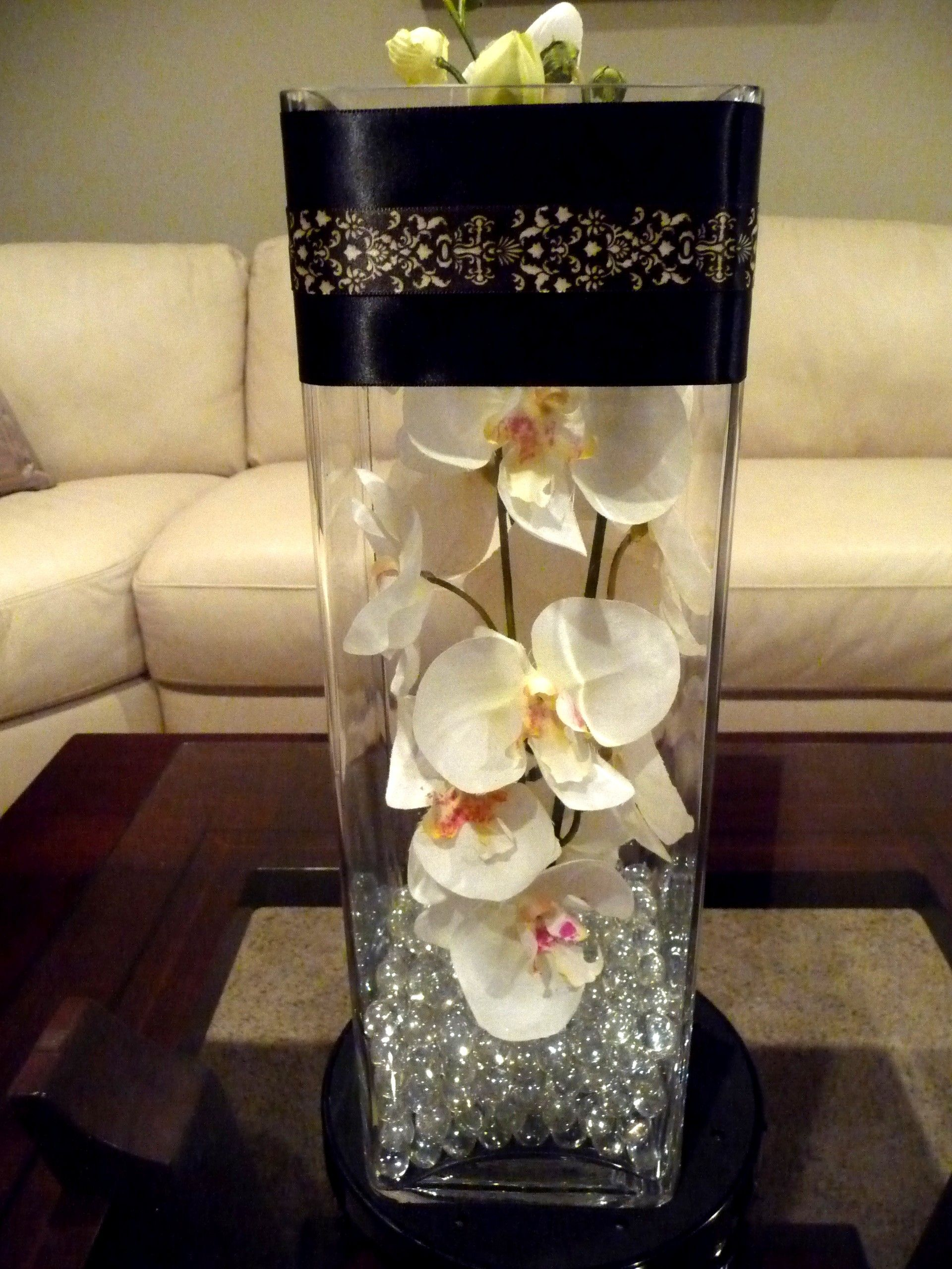 Photo via tall vases laser cutting and orchid diy 16tall vase filled with beads and orchids wrapped with black laser cut ribbon reviewsmspy