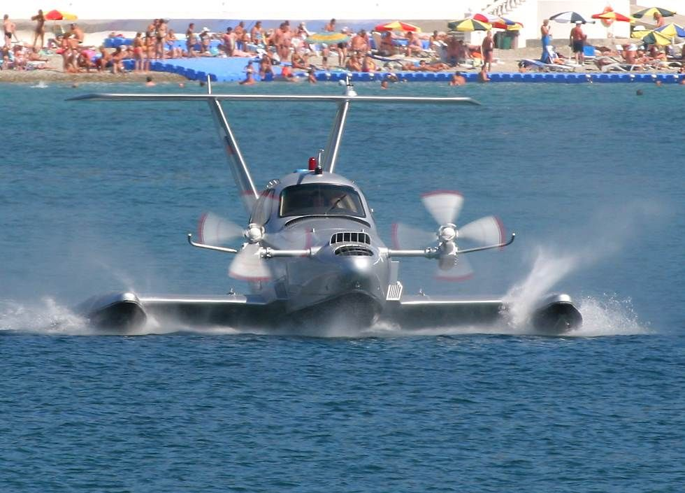 """The """"Aquaglide 5"""" is a five-seat """"wing in ground-effect"""" vehicle powered by a gasoline engine.   Part boat, part hovercraft, when travelling at speed this craft generates enough lift from its stub wings to fly 15 to 30 centimeters above the water."""