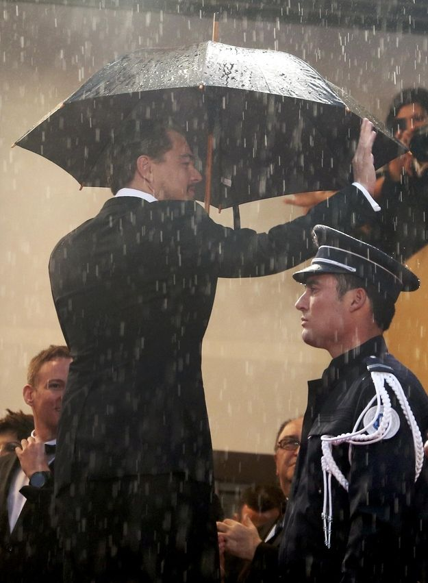 Leonardo DiCaprio waved in the rain.