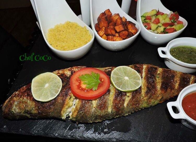Baked fish with attieke, and alloco