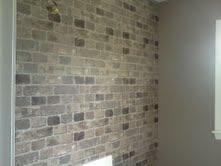 Brick wallpaper....i wonder how cheesy it looks