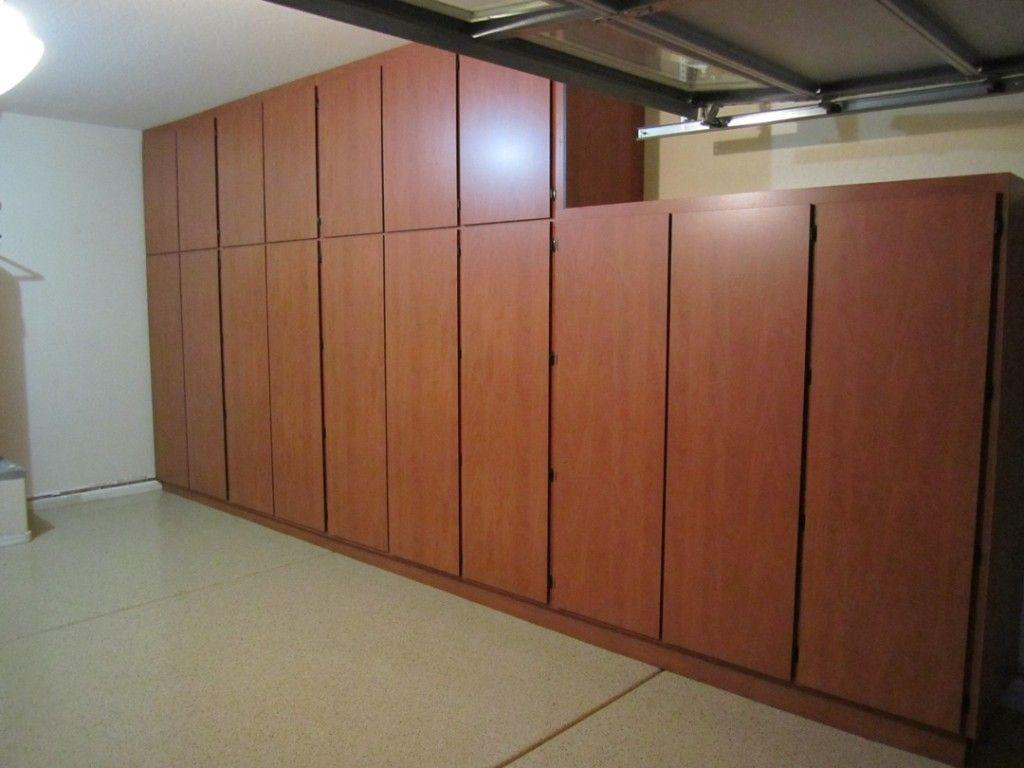 garage wall of cabinets organizer in steel transform proslat mount