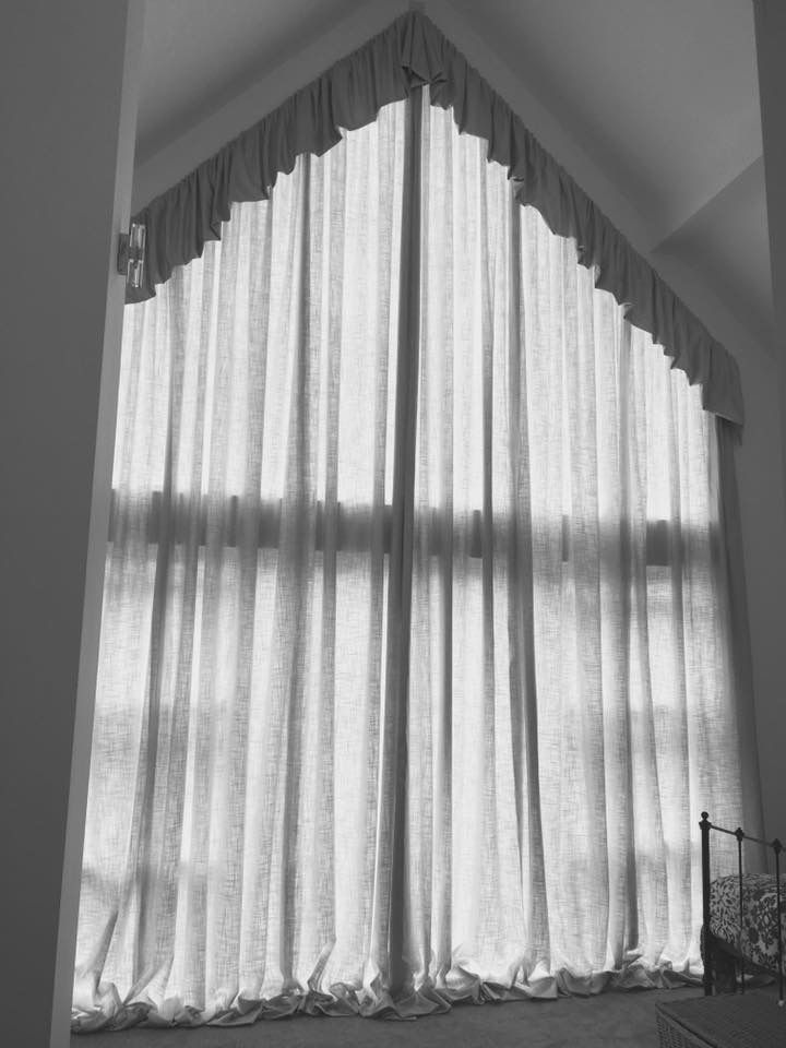 Puddled Curtains With Flop Over Top On An Apex Window By