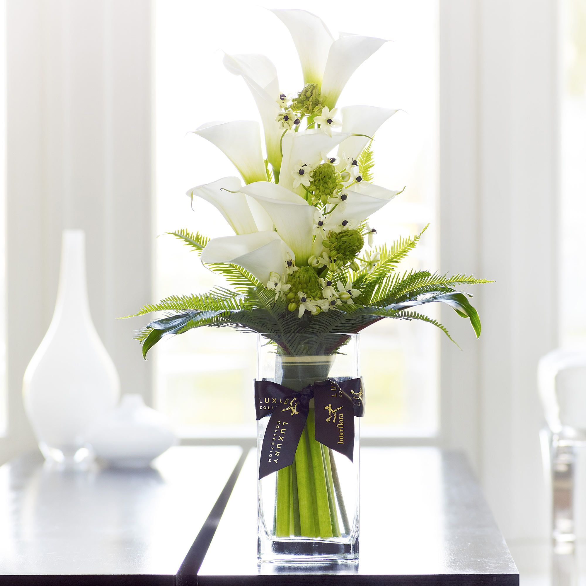 This luxury calla lily vase is an elegant arrangement for