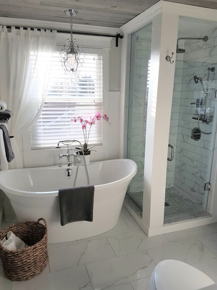 Freestanding Tub and Shower in farmhouse bathroom. ideas and inspo for remodeling #bathroomremodel