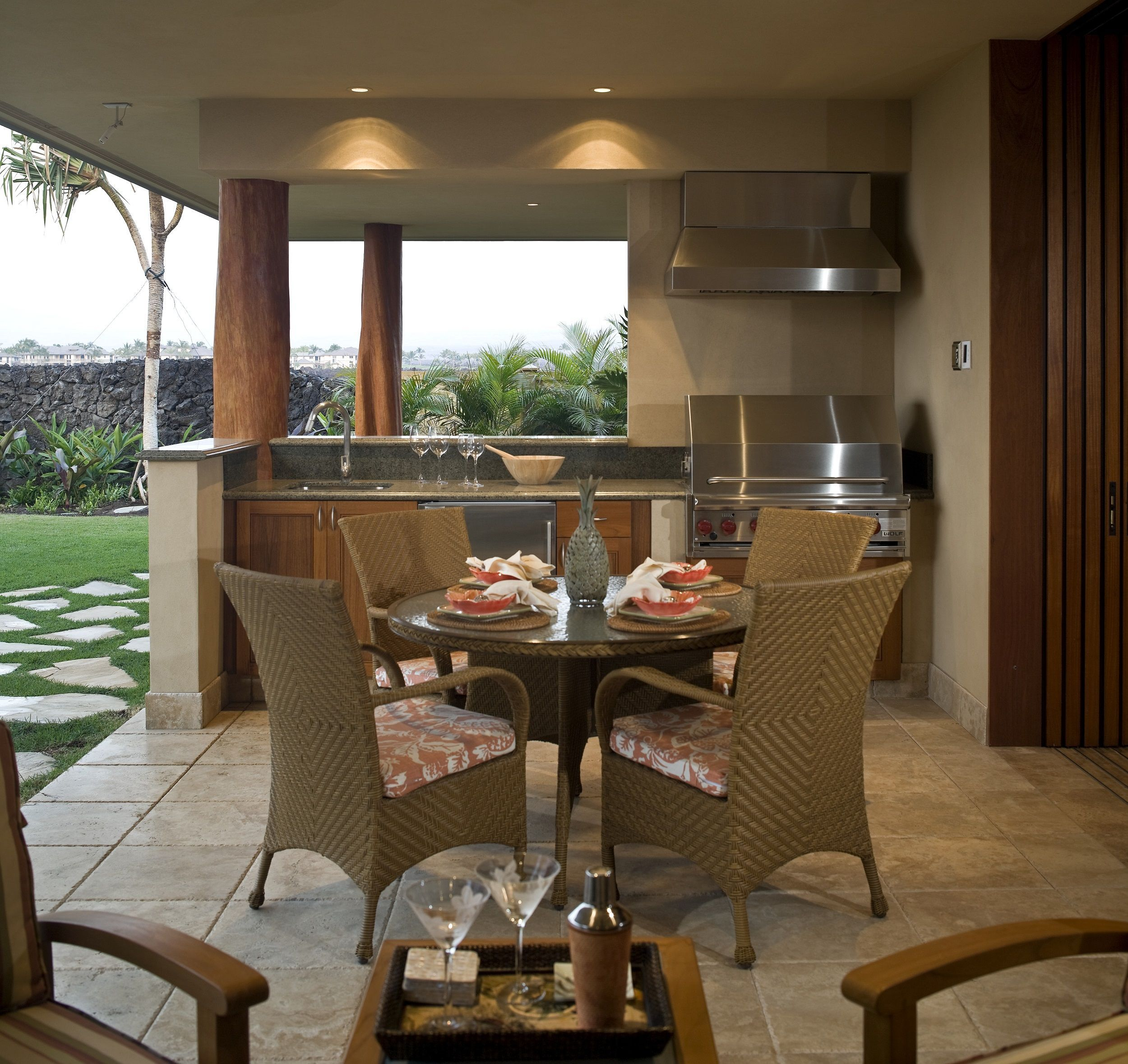 A Contemporary Outdoor Kitchen With Beautiful Tile Floors Stainless Steel Appliances And A Outdoor Kitchen Design Build Outdoor Kitchen Outdoor Patio Designs