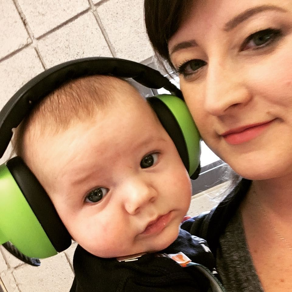Family Attending A Noisy Event Mini Muffs Protect The Hearing Of Baby Banz Earmuff Squiggle Under 2s