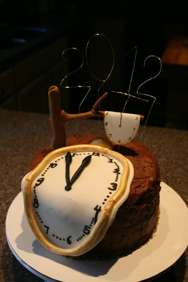 New Year's Eve Dali-esque Cake - Something a little different on the classic clock-themed cake.  Chocolate cake with mocha cream filling, covered in fondant with fondant accents.  Smaller clock draped over the tree branch is a Wilton sugar sheet.
