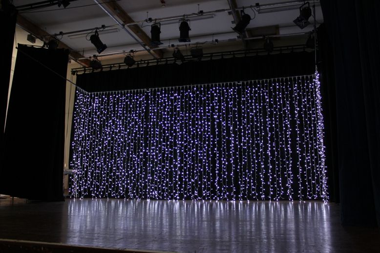 Curtains Of Fairy Lights For A Dramatic Backdrop On The Stage Set