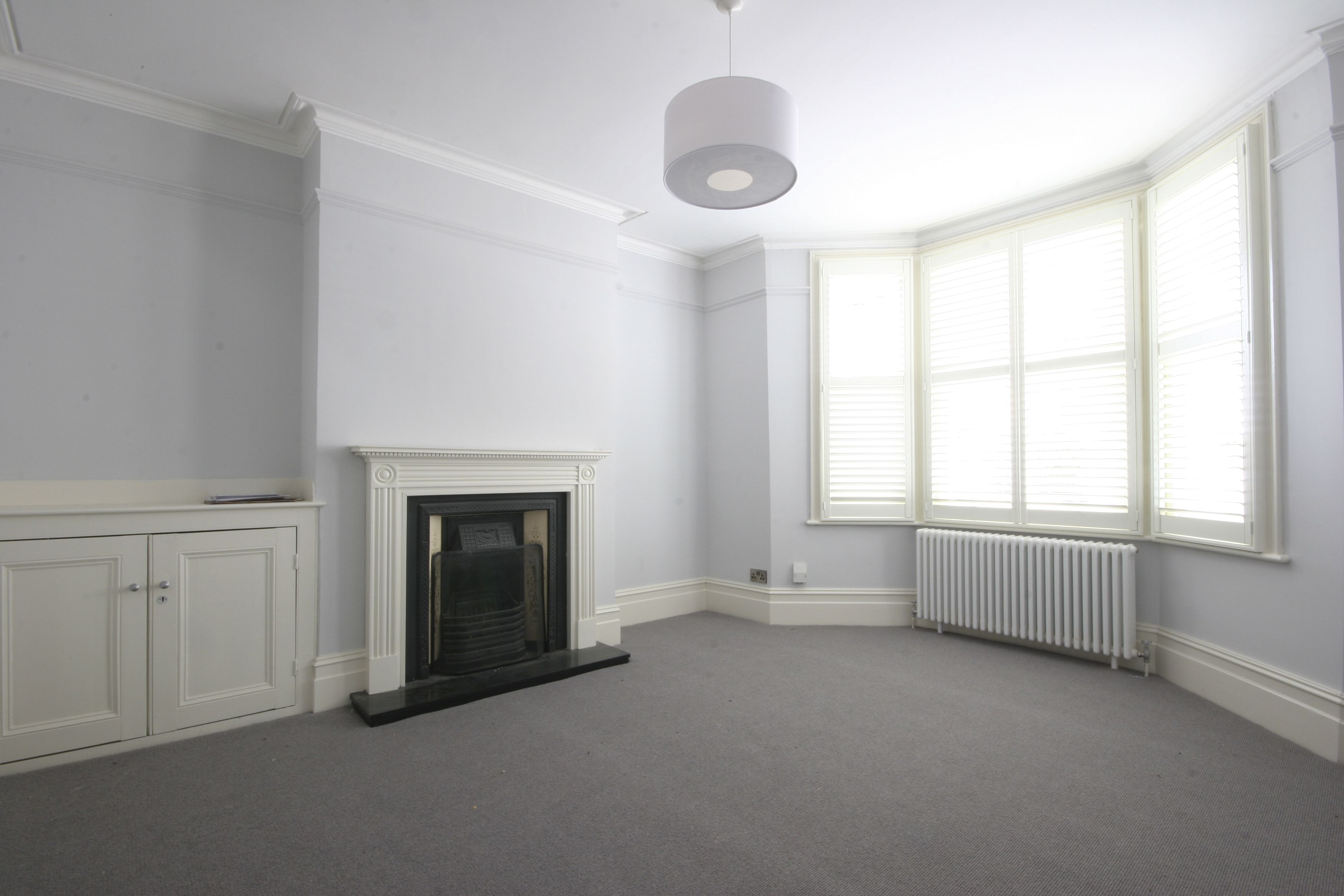 Sitting room painted in Little Greene \'Welcome\', plantation shutters ...