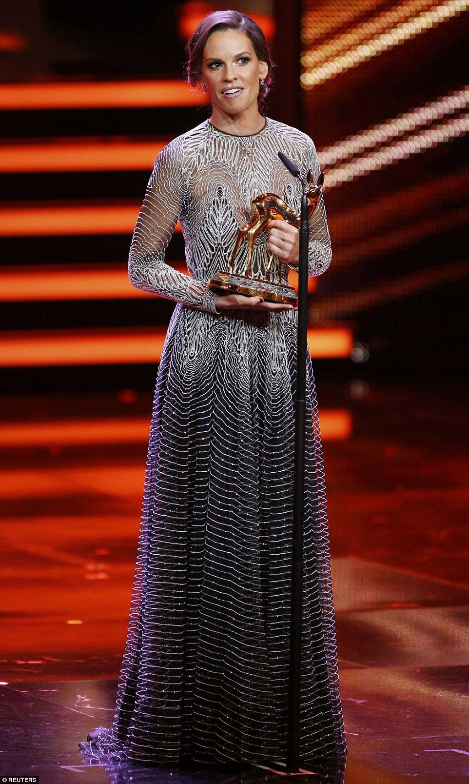 Lucky lady: Hilary was seen later in the evening clutching her award, which she was recogn...