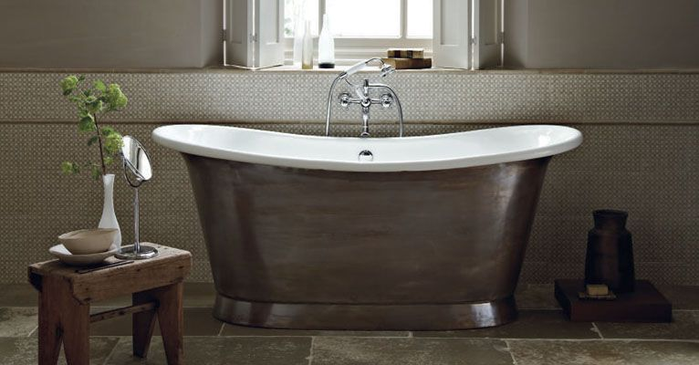 Love the colour and style of this bath: fired earth