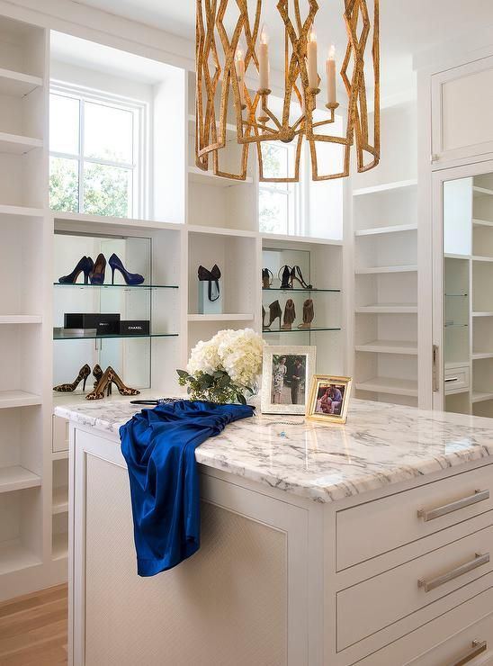 Gilded Lantern Illuminates A Marble Top Closet Island Fitted With Jewelry Drawers Surrounded By Built In Shoe S Build A Closet Closet Island Bedroom Renovation