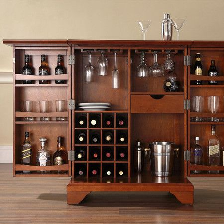 Expandable Bar Cabinet With A Sixteen Bottle Wine Rack And Hand