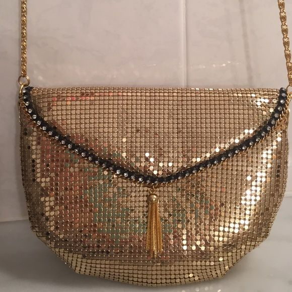 Gold metallic vintage purse with long chain Very flashy vintage clutch or use the long chain strap for a night out; super soft and like new inside and out; pretty black and faux diamond and tassel accents - super cute Vintage Bags