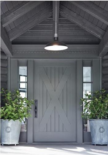 Beautiful And Unique Modern Farmhouse Exterior Entry With X Design On Planked Door Hanging Barn Style Pendant Light Huge Planters Rustic Grey Painted