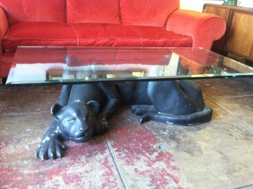 this large black panther coffee table is nothing but cool. the