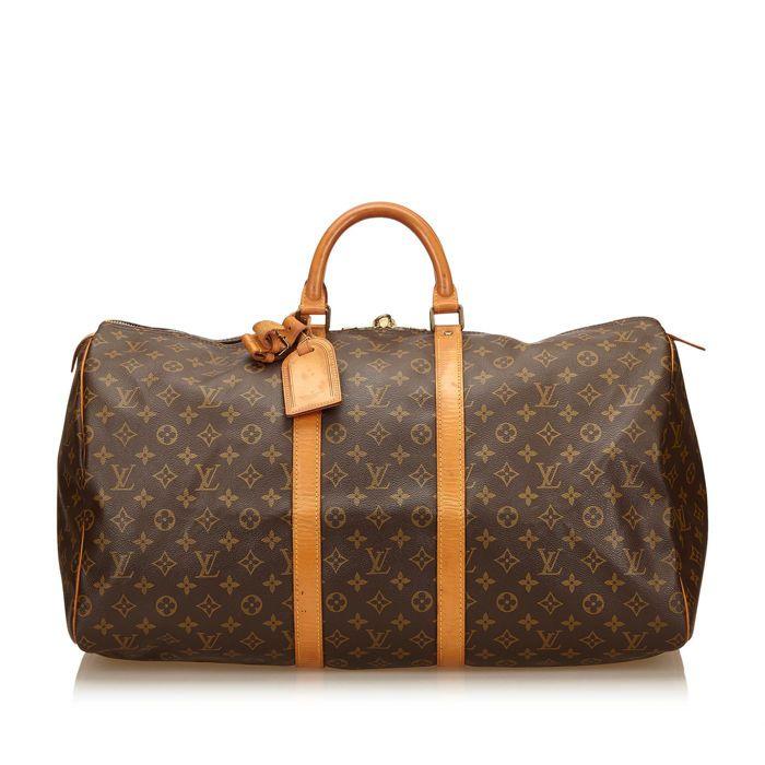 d7393da8baf0 Louis Vuitton - Monogram Keepall 55 De 55 Keepall beschikt over een  monogram canvas lichaam rolde