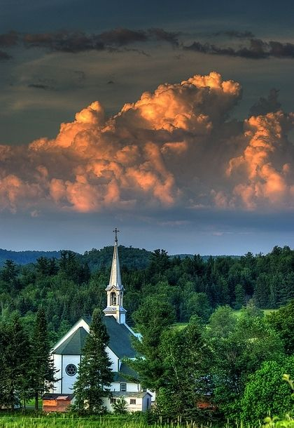 beautiful cloud formation over white church