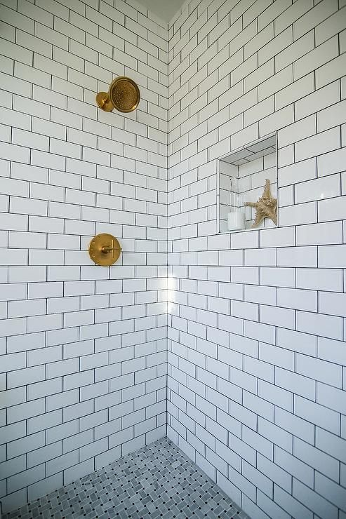 Stunning Shower Features Walls Clad In White Subway Tiles Accented