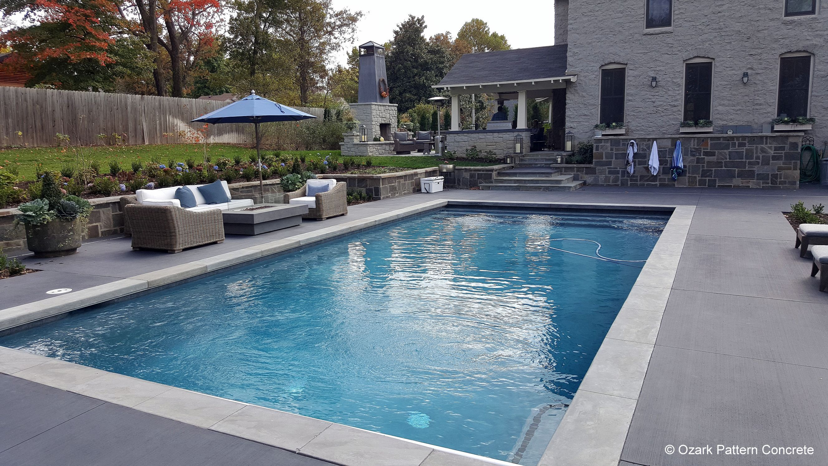 Colored Concrete Pool Deck with Contrasting Coping  Concrete pool