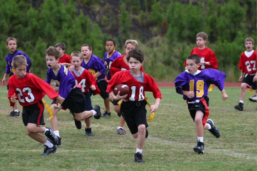 This Image Specifically Uses Kids In An Attempt To Make The Viewer Feel More Youthful Thus Wanting To Attend The Nfl Flag Football Football Kids Flag Football
