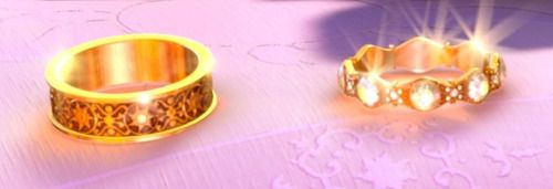 """Since I had never really saw a picture of Rapunzel and Eugene's wedding rings close up, I decided to find a high quality picture and zoom up on them. Anyway, I cropped a picture and saved it. ^-^  """
