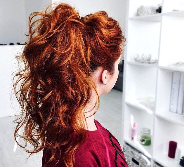 long curly red high ponytail with slight hair bump high