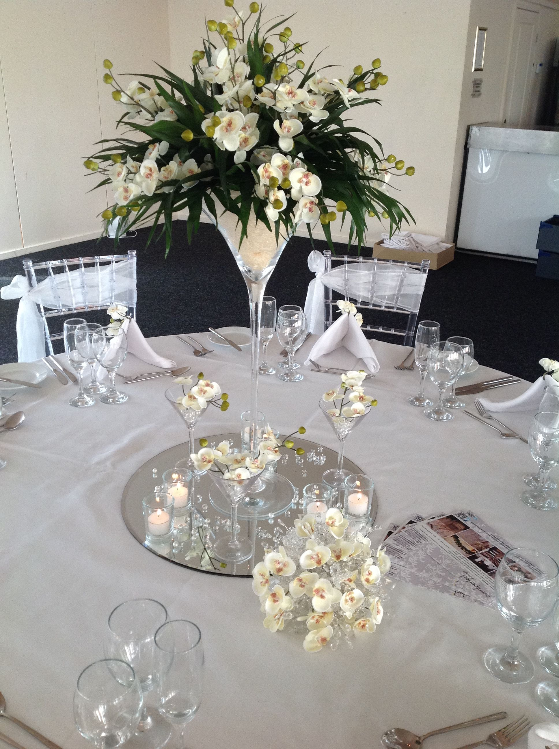 Mirror Tiles For Table Decorations Floral Arrangement Set In A Martini Glass On Mirror Tile Base With