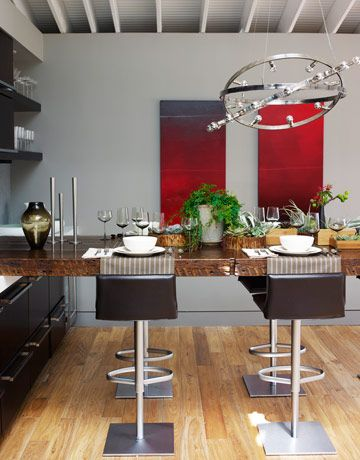 The dining table is made of reclaimed wood by Jeff Soderbergh. Wall paint is Benjamin Moore's Cape May Cobblestone. Leather-covered Bottega stools from Design Within Reach swivel 360 degrees.   - HouseBeautiful.com