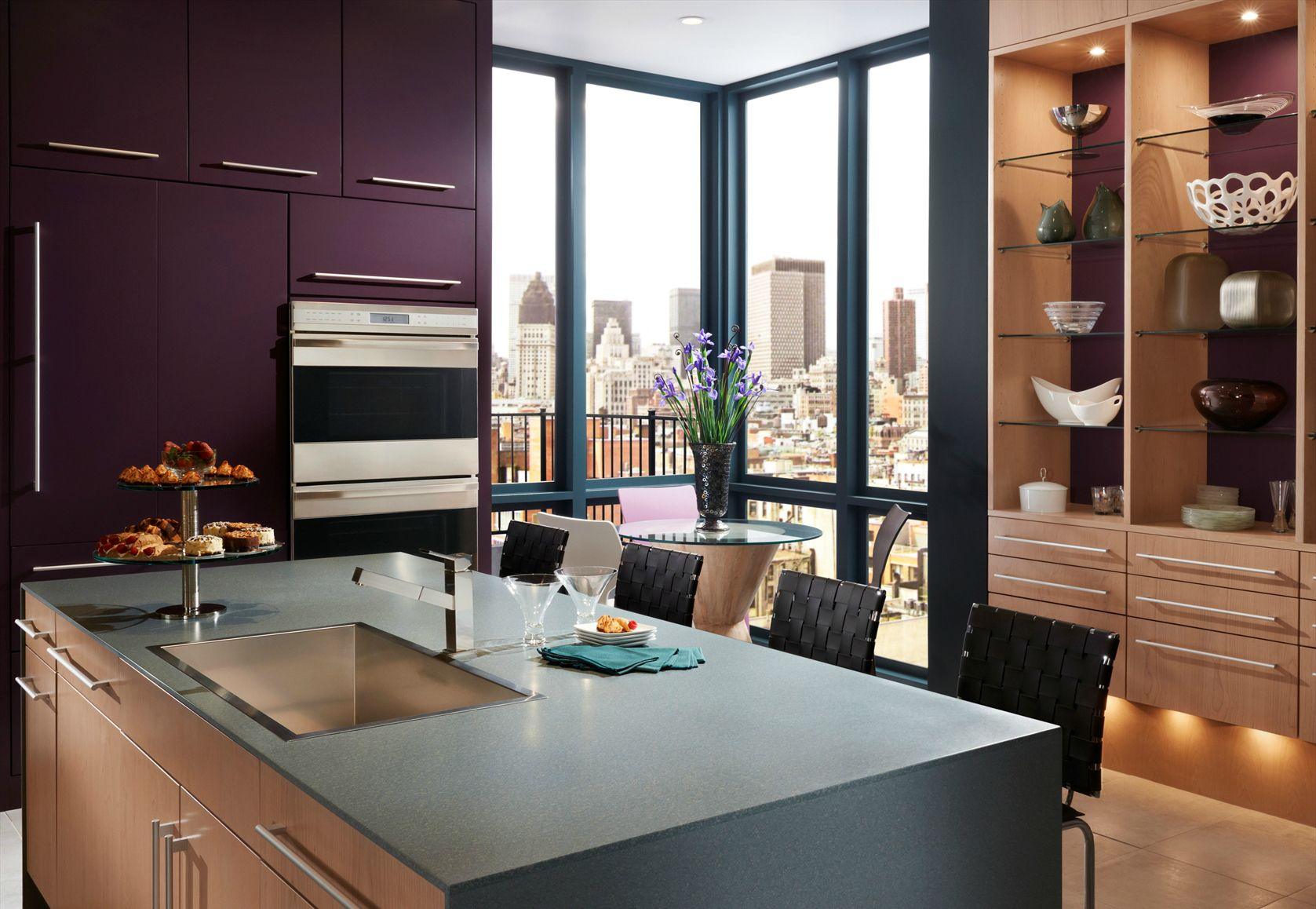warm wood meets bold designer color in this vibrant kitchen