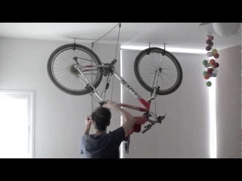Bike Storage With Pulling The Bike Up Flush To The Ceiling Bike Storage Diy Bike Storage Garage Bike Storage Solutions